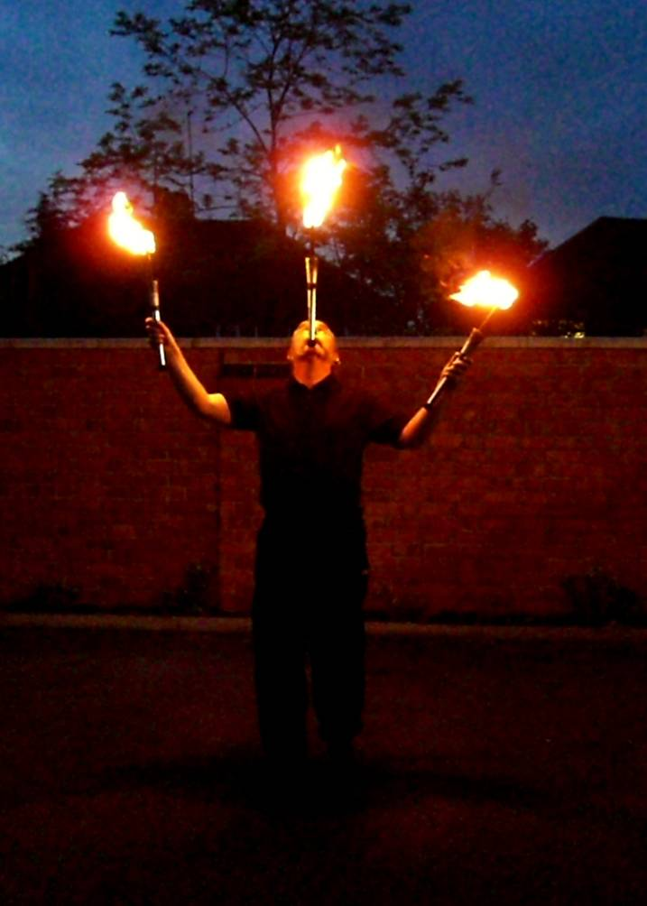 Andy balancing fire clubs