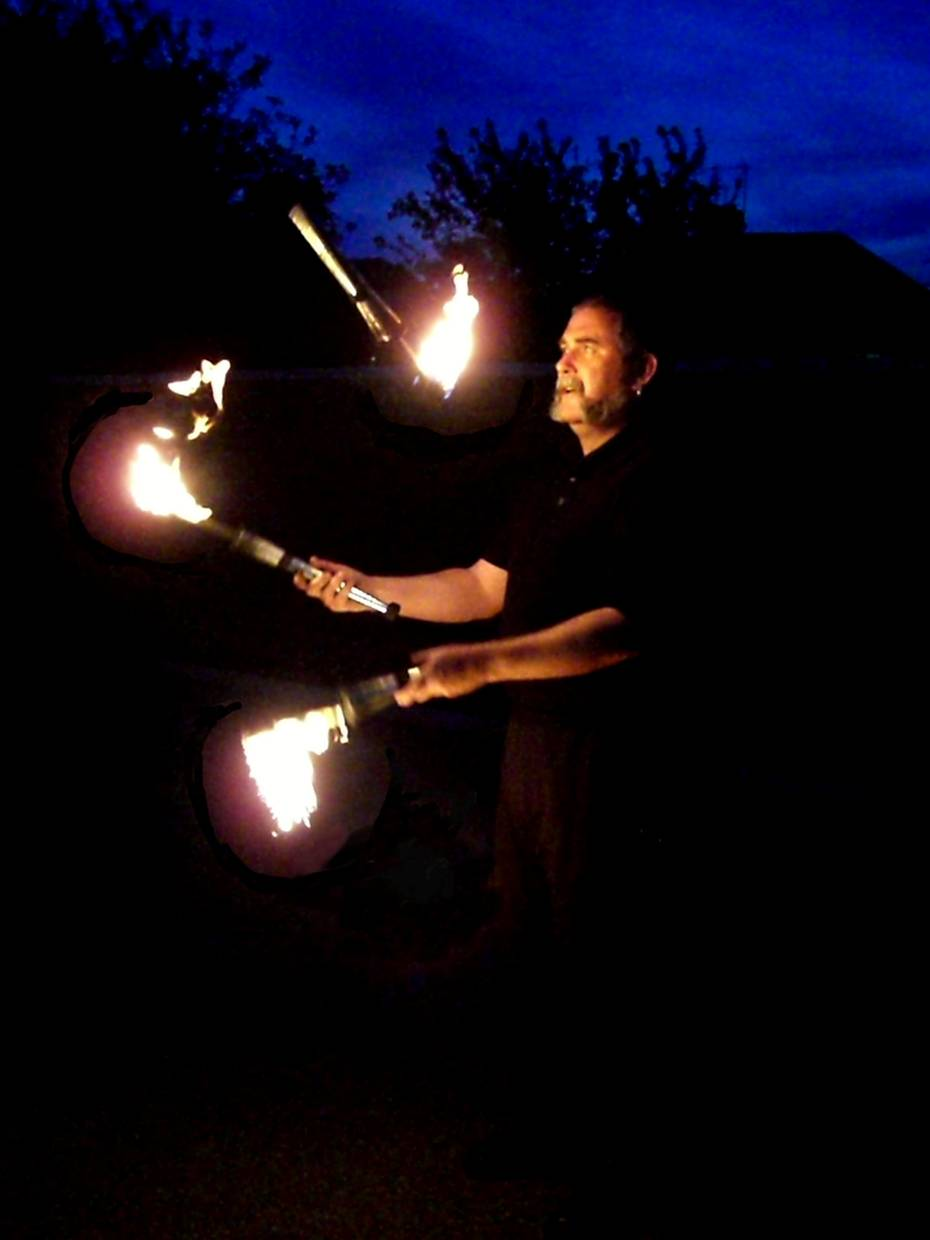 Andy juggling fire clubs